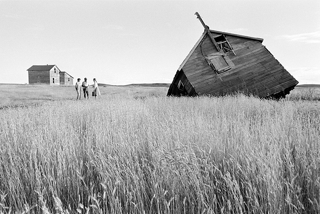 Farmers Randy & Lois Oster speak with lawyer activist Sarah Vogel on their farm, which is facing foreclosure, North Dakota, 1982, Grey Villet, Archival Pigment Print, Dimensions:16 x 20