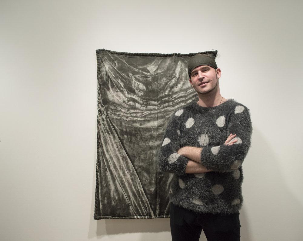 Curator Efrem Zelony-Mindell