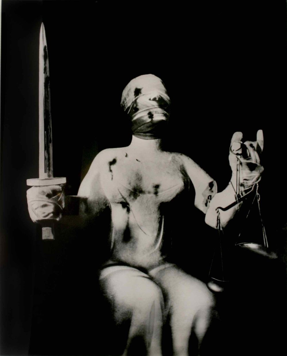 "John Heartfield (1891-1968) Der Henker und Die Gerechtigkeit (""The Executioner and Justine""), c. 1933 gelatin silver print 37 x 29 1⁄2 inches courtesy Ubu Gallery, New York."