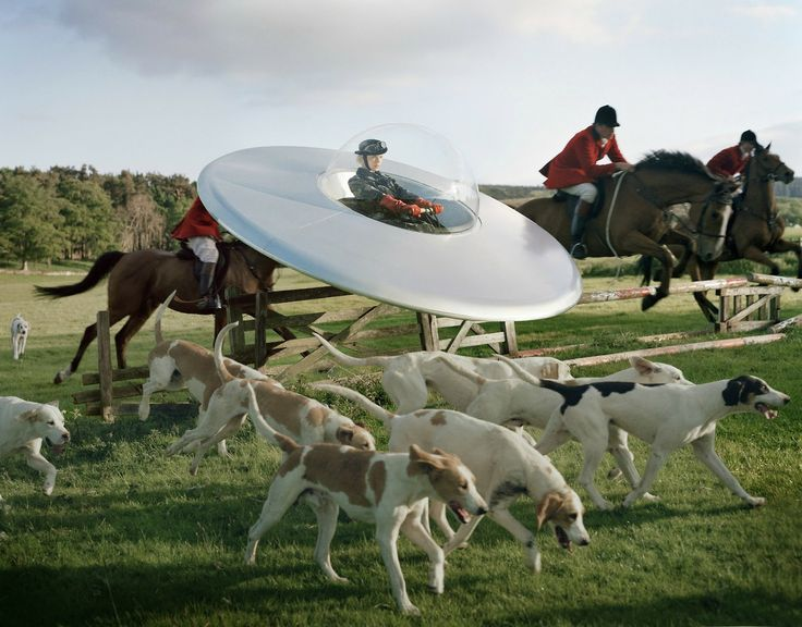 'Kinga Razjak in a flying saucer with members of the West Percy hunt'  2009 © Tim Walker