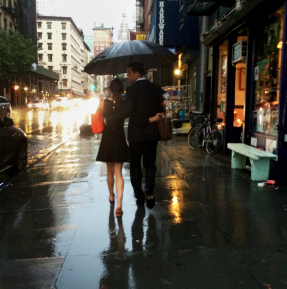 Couple in the rain. New York, NY, USA June 13, 2014, 6:50:56pm  Latitude: 40°42'58''N, Longitude: 74°0'36''W   © Robert Herman