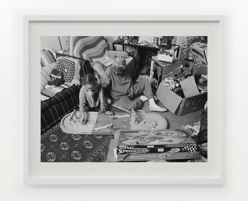 Grandma Ruby and J.C. Playing with Christmas Toys in Her Living Room,  2006 © Latoya Ruby Frazier