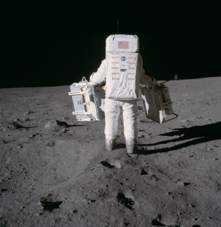 """ Astronaut Edwin Aldrin prepares to deploy EASEP on surface of moon "" Image courtesy of NASA"