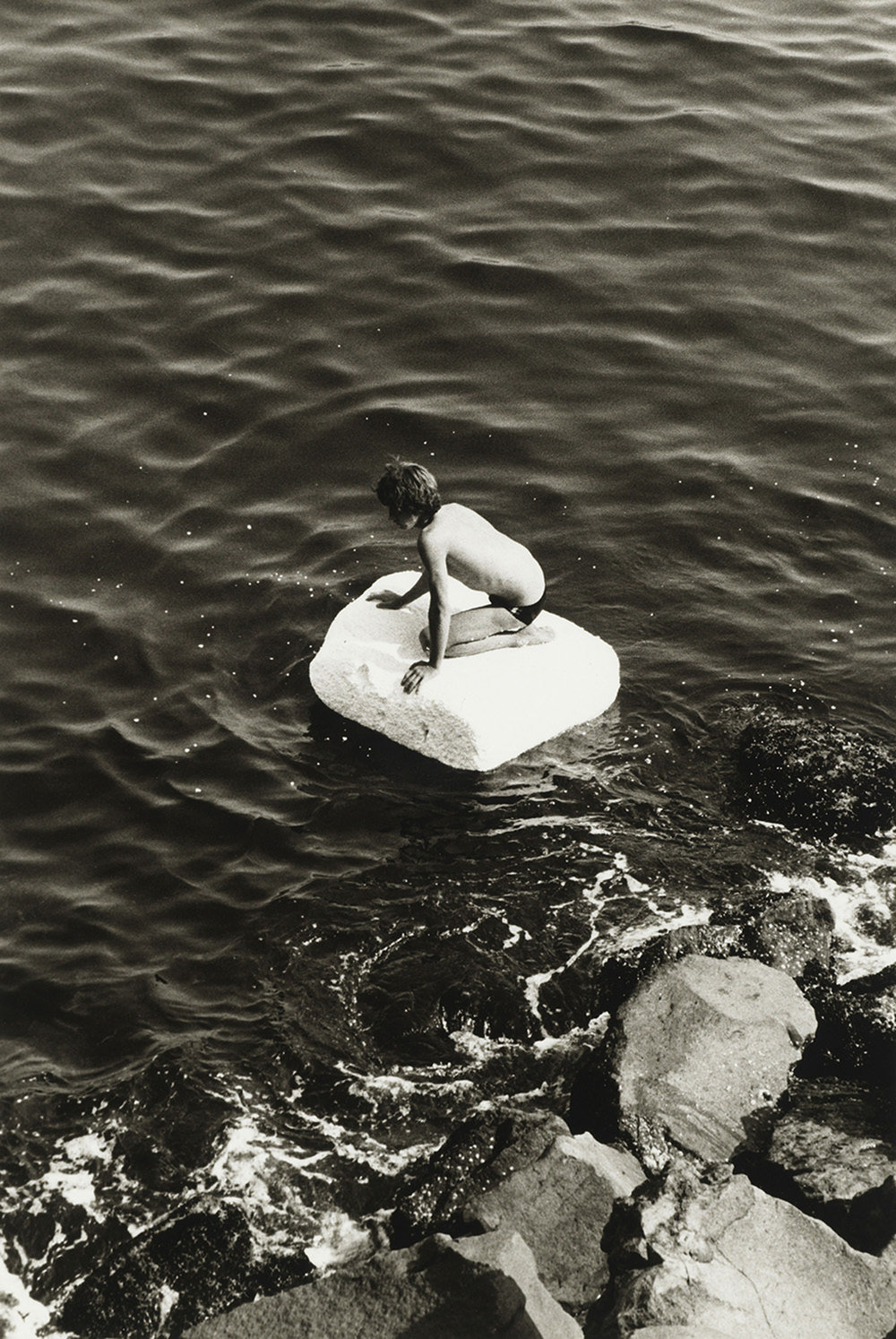 Boy on Raft, 1978, gelatin silver print, purchased on the Charina Endowment Fund, The Morgan Library & Museum, 2013.108:1.97. © Peter Hujar Archive, LLC, courtesy Pace/MacGill Gallery, New York and Fraenkel Gallery, San Francisco.