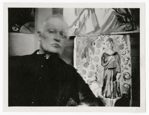 Edvard Munch Self-Portrait Wearing Glasses and Seated Before Two Watercolors at Ekely, ca. 1930 Original: Gelatin silver contact print Courtesy of Munch Museum