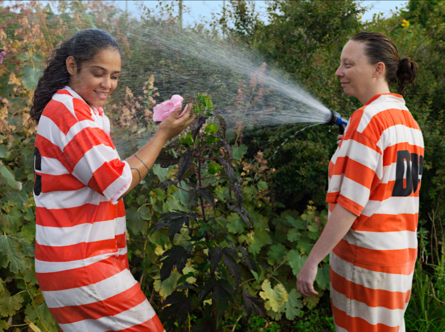Lucas Foglia, Vanessa and Lauren watering, GreenHouse Program, Rikers Island jail complex, New York, 2014 © the artist and courtesy Fredericks & Freiser Gallery, New York