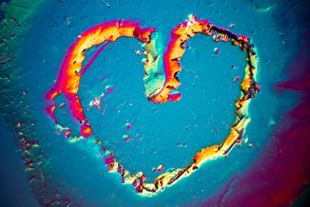 A natural heart shape etch feature was present on the surface of a beryl crystal. This image was taken using differential interference contrast microscopy. The horizontal field of view is 1.1mm.© Nathan Renfro