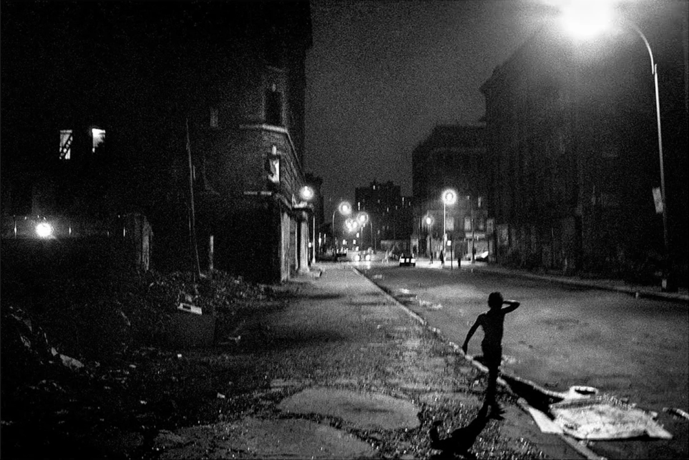 Ken Schles,  Boy on East 5th Street, 4th of July , 1984