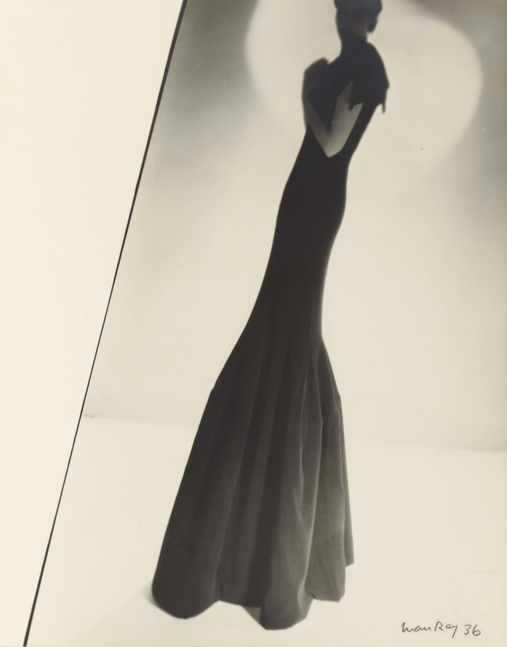 MAN RAY (American, 1890–1976),  Model Wearing a Gown by Augustabernard , 1936. Gelatin silver print 28.9 × 22.7 cm (113⁄8 × 815⁄16 in.) Los Angeles, J. Paul Getty Museum, 84.XM.1000.53. © Man Ray Trust ARS-ADAG
