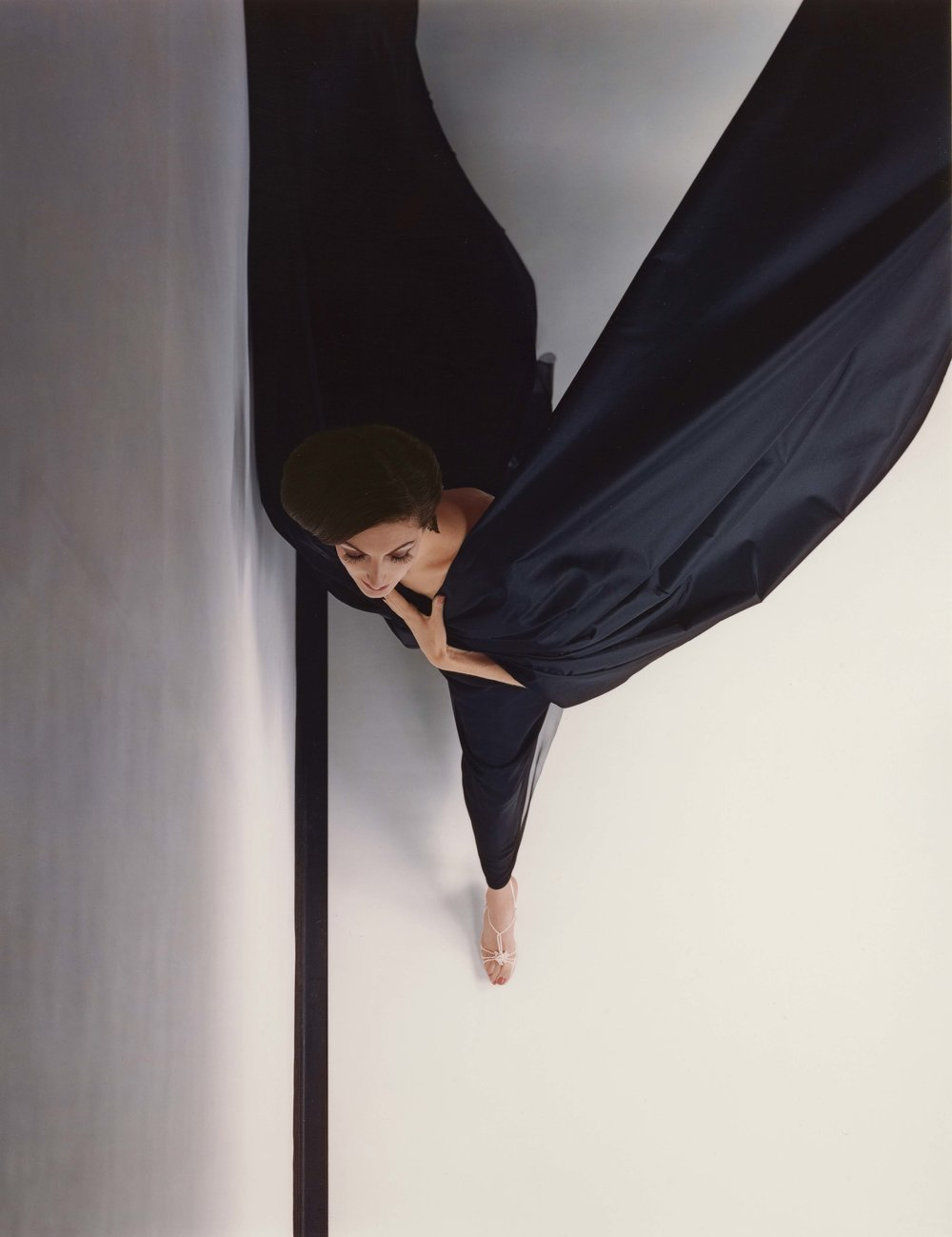 HIRO (American, born China, 1930),  Black Evening Dress in Flight, New York , negative, 1963; print, 1994. Dye imbibition print 48.9 × 38.1 cm (191⁄4 × 15 in.) Los Angeles, J. Paul Getty Museum, Purchased with funds provided by the Photographs Council, 2012.24.2. © Hiro
