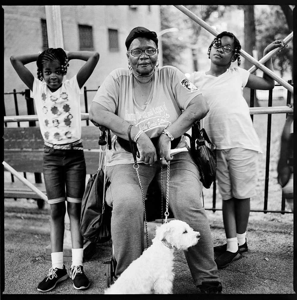 "A Claremont resident known to all as ""Auntie Shirley"" with her two grandchildren. August, 2017.  © Michael Kamber/Bronx Documentary Center"