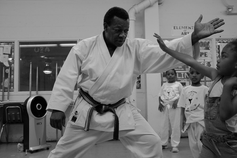 Sensei Dozier for decades has taught karate to Claremont village residents. August 2017.  © Osaretin Ugiagbe/Bronx Photo League