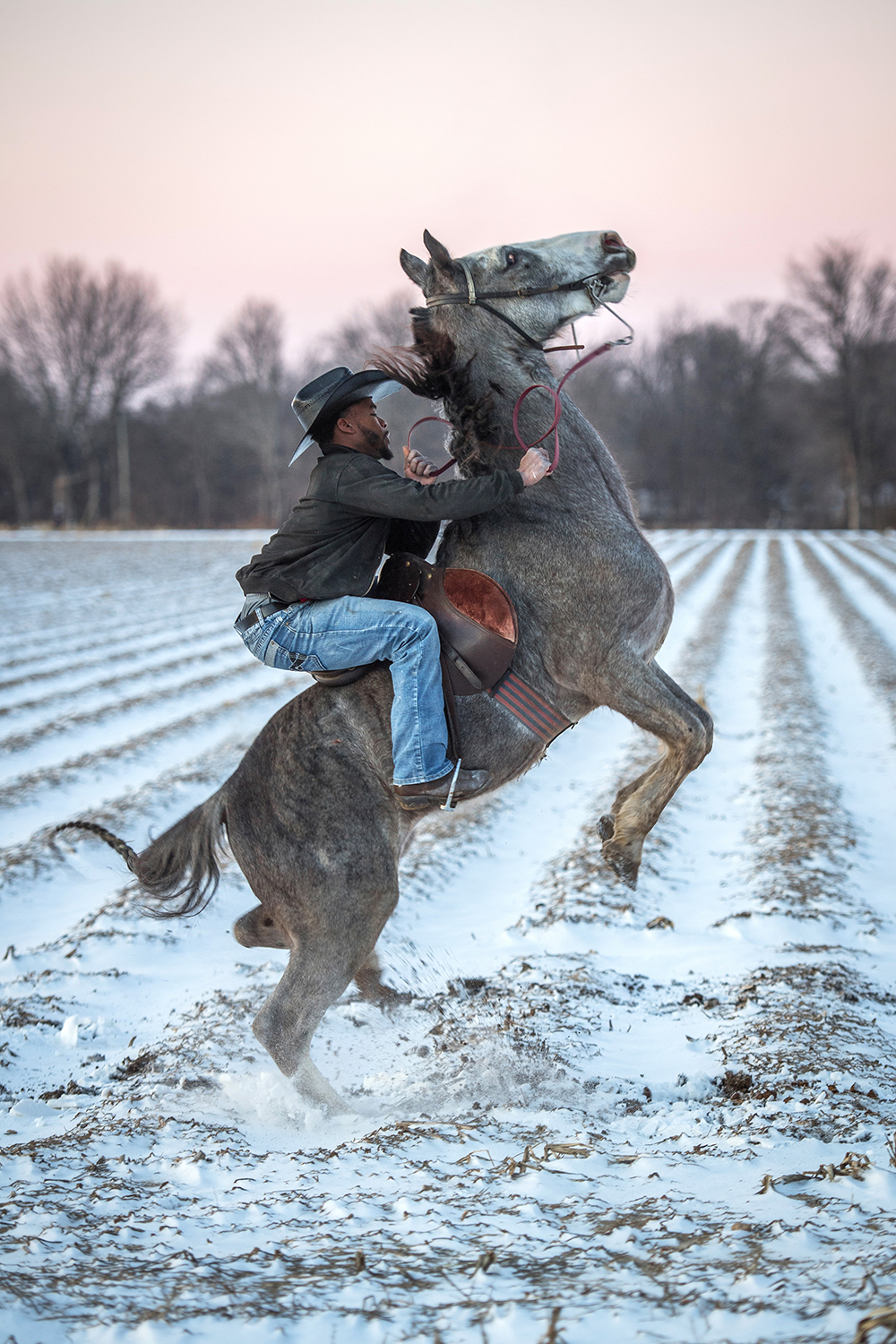 A young cowboy named Gee rises on his horse after a rare snowfall in Cleveland, Mississippi. Photo by Rory Doyle.