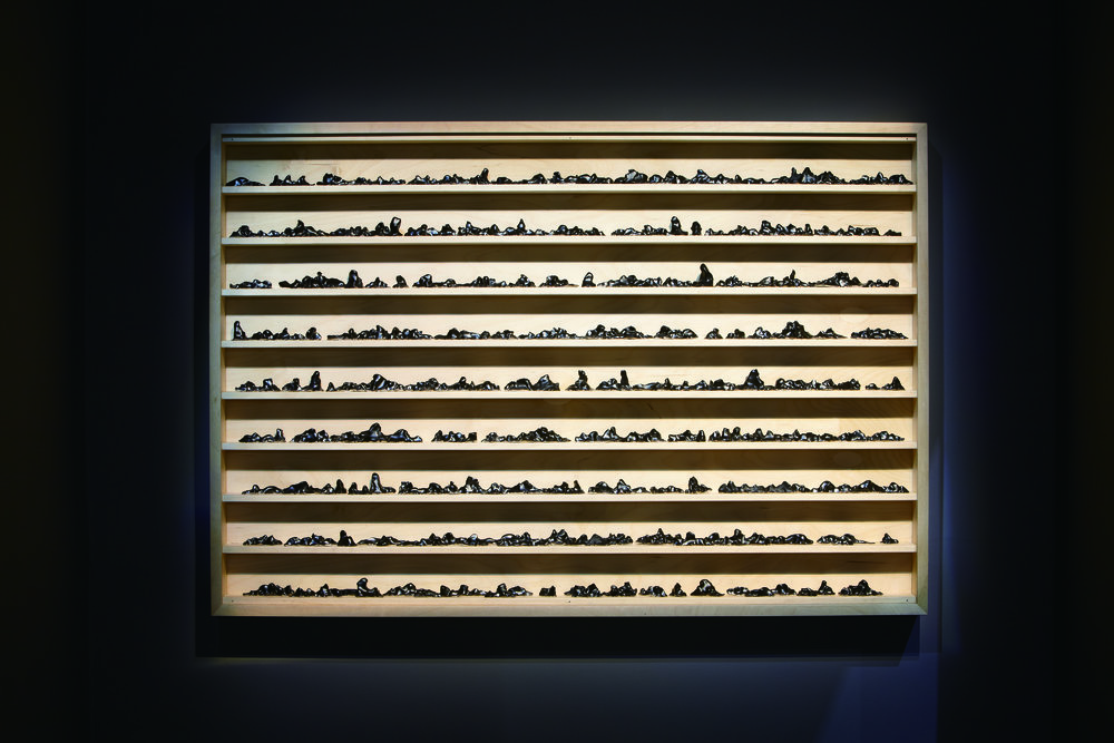 Bae Youngwhan, Ten Thousand Years Sleep - Black, 2010, Black-glaze porcelain objects in artist's cabinet of plywood and glass, 57.7 x 39.6 x 4.1 inches (146.5 x 100.5 x 10.5 cm).Courtesy of the artist and Jane Lombard Gallery.