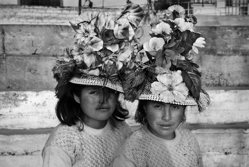 Two girls from Huancavelica stand for a portrait during the International Festival of Street Theater in La Balanza (Fiteca), Comas. Lima, Peru, 2015. © Sharon Castellanos / VII Mentor Program