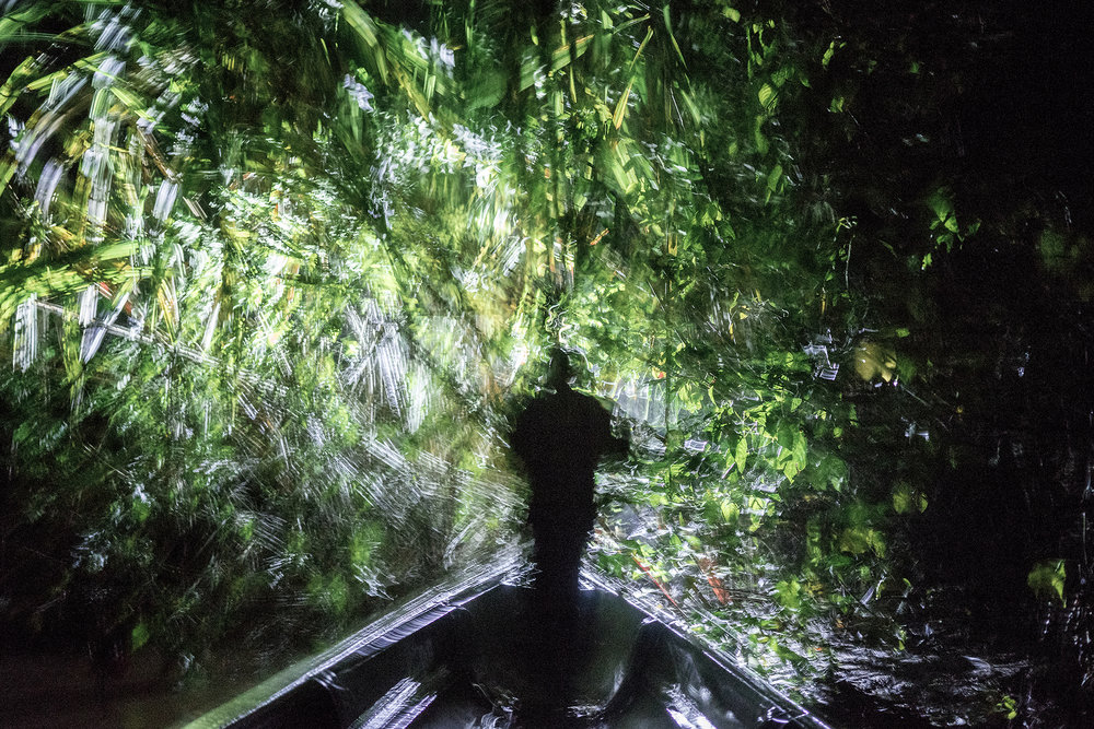 Jose Miguel Santi leading a night hunting expedition on his cousin's boat in the Ecuadorean Amazon. © Misha Vallejo