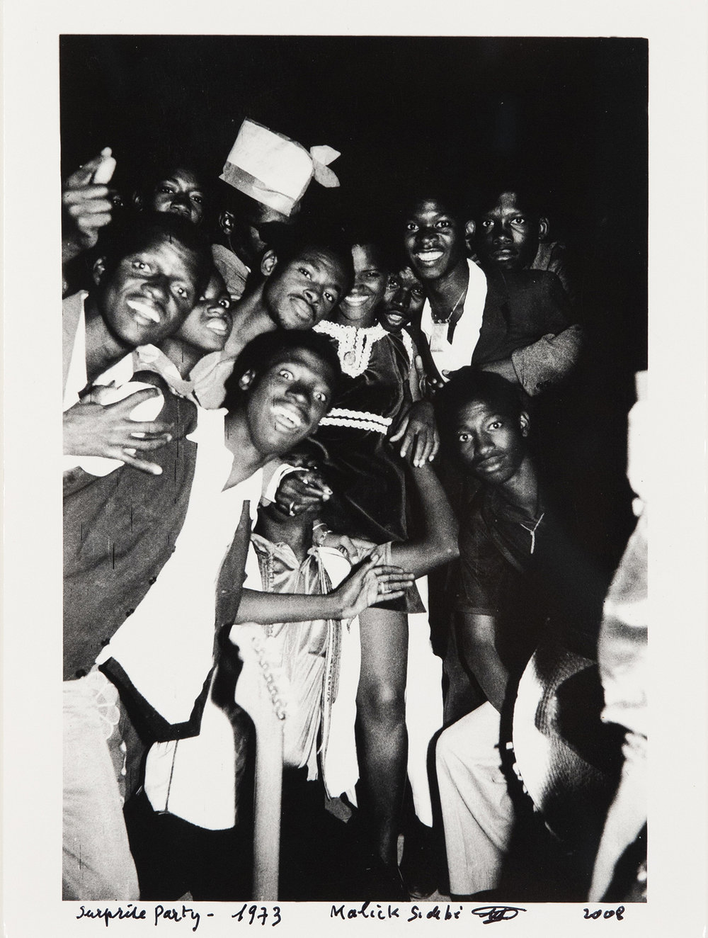 Surprise Party , 1973/2008, gelatin silver print, 8 3/4 x 5 7/8 inches image size, 9 5/8 x 7 inches paper size, signed, titled, and dated on front. Image courtesy Jack Shainman Gallery.