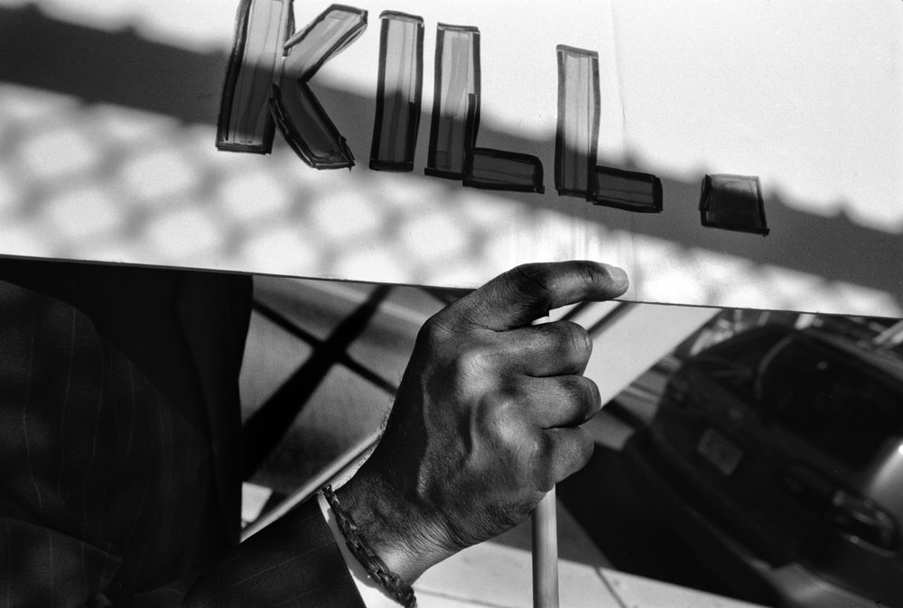 New York's Lucifer © Tomeu Coll  Domestic Violence Rally. Bronx. NY 2007