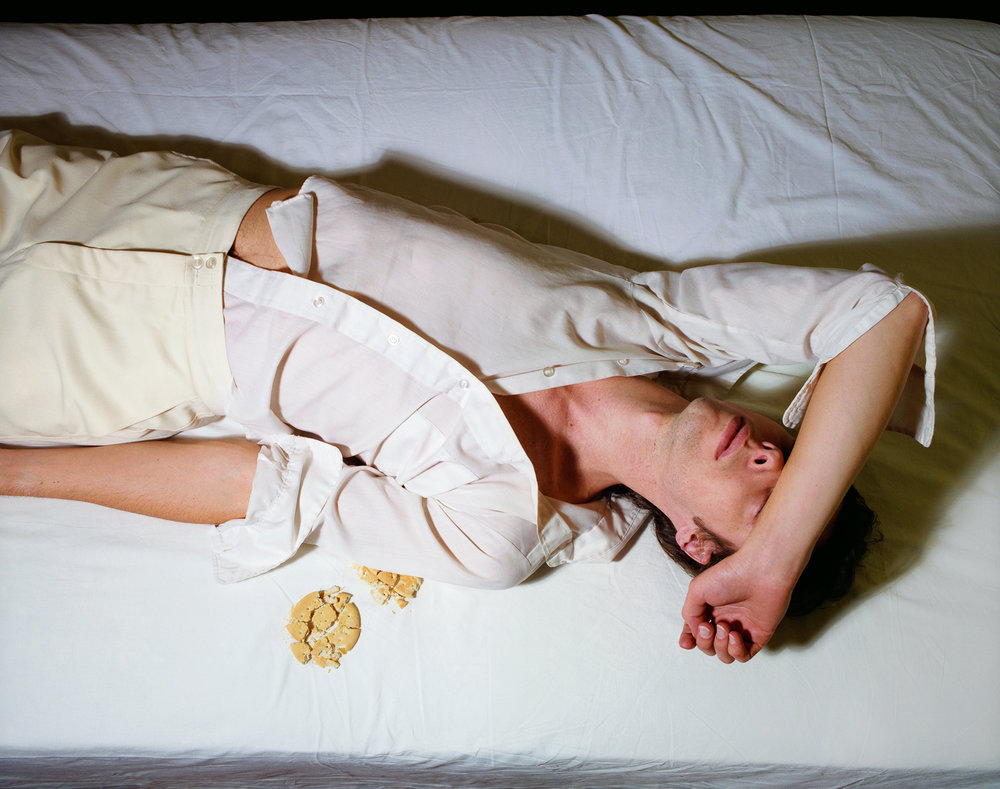 Now and Then © Jo Ann Callis   Man on Bed with Crumbs , 1979, Archival Pigment Print, 16 x 20 inches