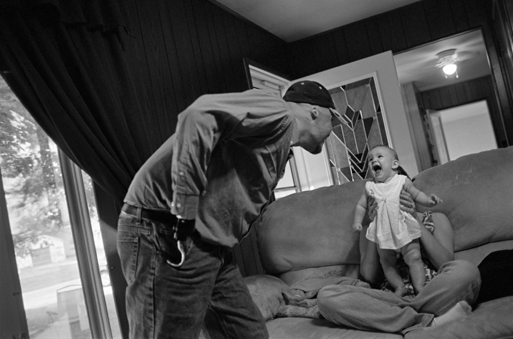 Dustin Hill with his daughter, Mineral, Illinois  , 2008. Gelatin silver print.  Collection of Eugene Richards. © Eugene Richards