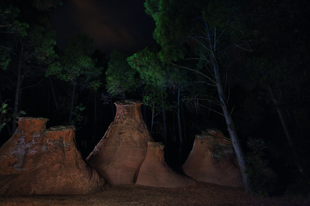 Outside the village of Bedoin, these rock formations called the Demoiselles Coiffees (coiffed young ladies) are made when layers of stone are eroded by wind and rain. They are also known as  cheminees de fee  (fairy chimneys) © Rachel Cobb. Courtesy of Damiani.