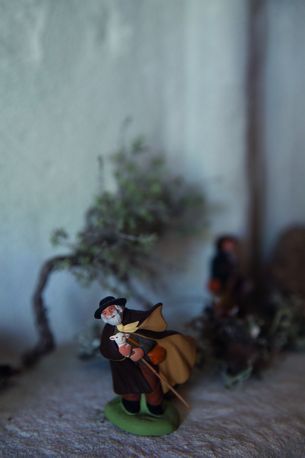 A windblown shepherd  santon .  Santons  are clay figurines of saints represented by ordinary Provencal characters and used in creche sets at Christmastime. They were first first made during the French Revolution when churches were closed and nativity scenes were forbidden. People took to creating their own creche sets with local characters instead of known saints. © Rachel Cobb. Courtesy of Damiani.