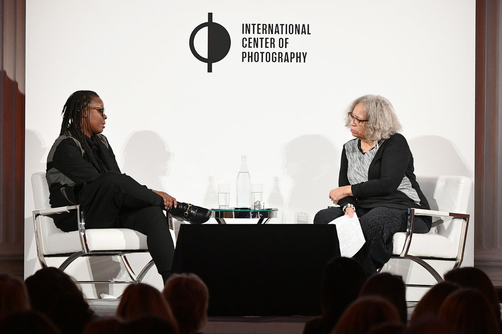 Mickalene Thomas and Beverly Guy-Sheftall speak on stage at the ICP Spotlights Luncheon Honoring Mickalene Thomas ©Getty Images for ICP