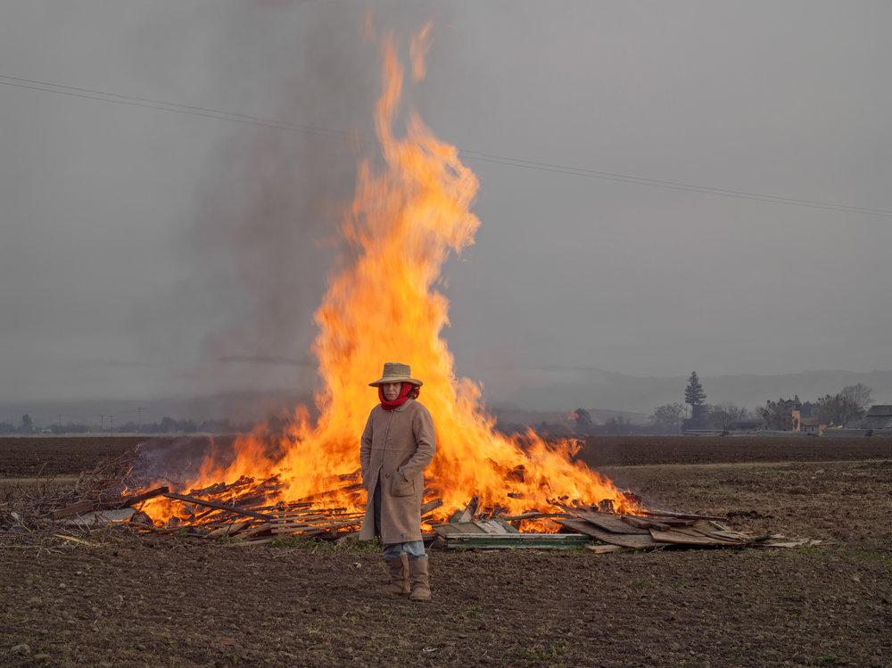© Lucas Foglia Alicia Clearing Land for Farming, California 2012