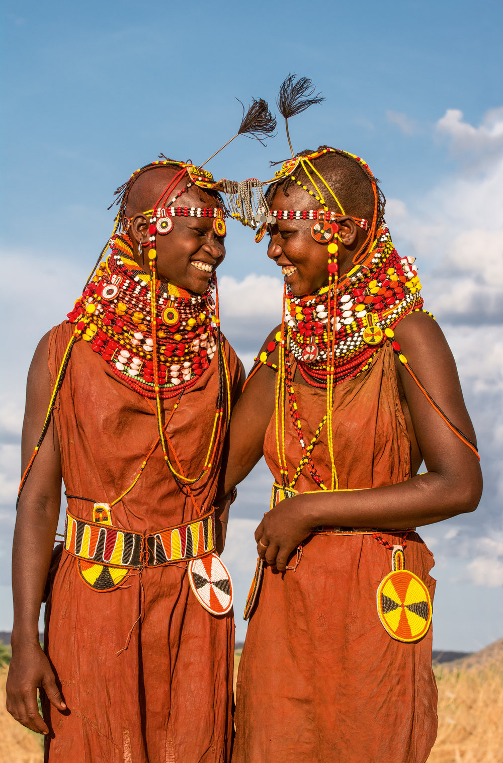 Unmarried girls wear brightly beaded necklaces, belts, and medallions. They often wear more vibrant colors than married women to attract the eye of potential husbands during the courtship dance. © African Twilight: The Vanishing Cultures and Ceremonies of the African Continent by Carol Beckwith and Angela Fisher, Rizzoli, 2018.