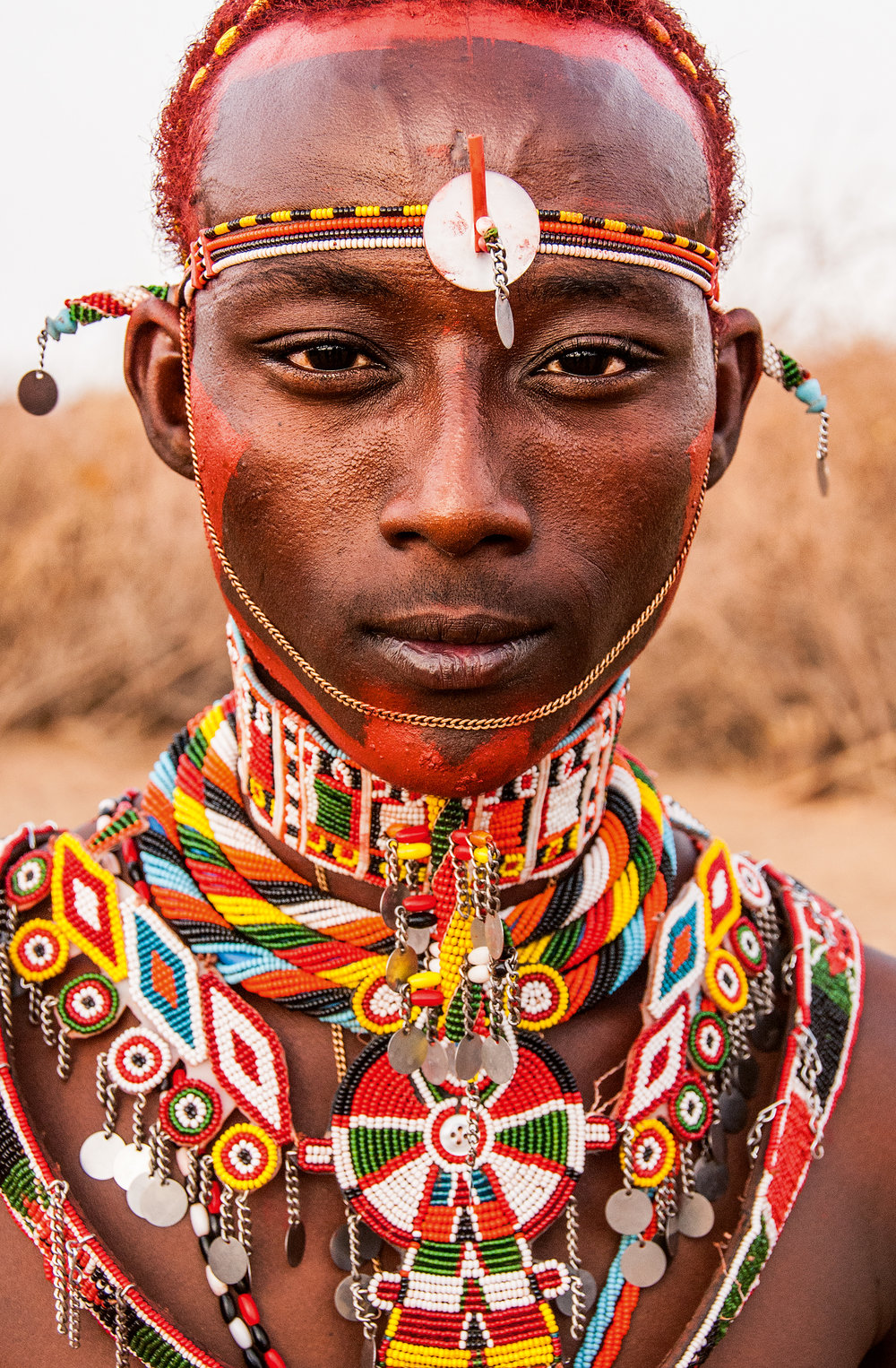 Portrait of a young warrior at the close of the Herr Heroon ceremony. © African Twilight: The Vanishing Cultures and Ceremonies of the African Continent by Carol Beckwith and Angela Fisher, Rizzoli, 2018.