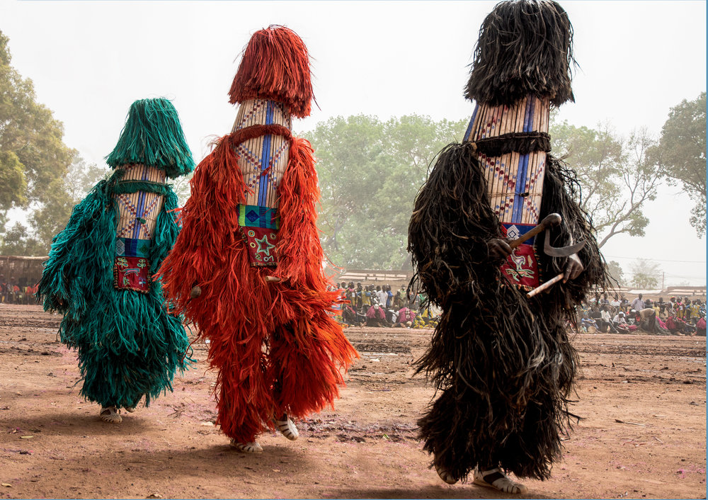 Millet-stalk masks from the village of Balave dance to the accompaniment of rapid drumming. They appear wearing the totem colors of the four main Balave families. © African Twilight: The Vanishing Cultures and Ceremonies of the African Continent by Carol Beckwith and Angela Fisher, Rizzoli, 2018.