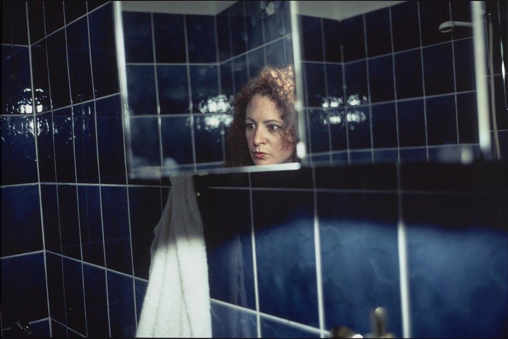 """Self-Portrait in My Blue Bathroom, Berlin"". Nan Goldin (American, born in 1953). 1991. Photograph, silver-dye bleach print. * Horace W. Goldsmith Foundation Fund for Photography. © Nan Goldin* Photograph © Museum of Fine Arts, Boston"