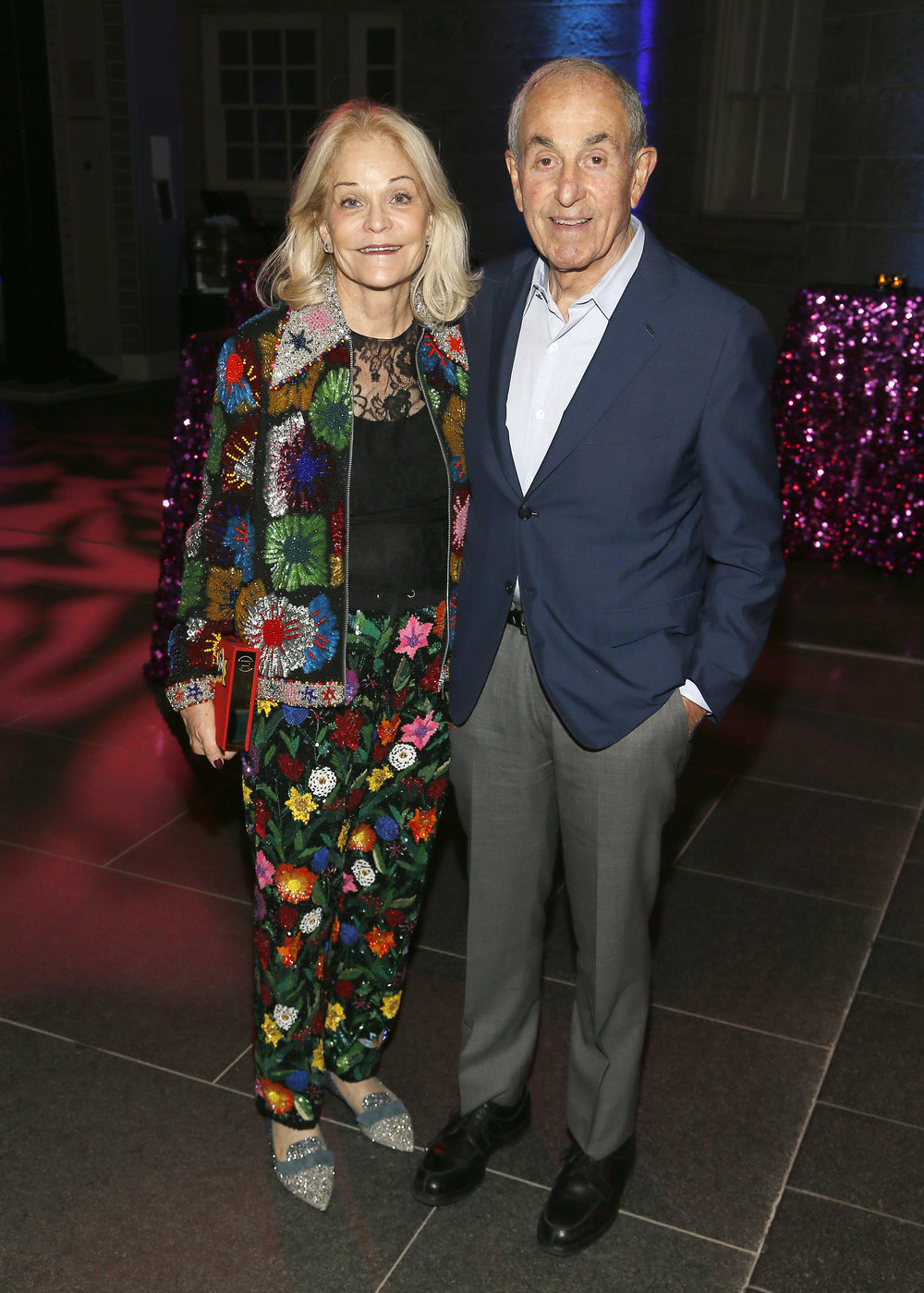 """Left to right: Catherine Podell and Michael Podell attend the """"Face Forward Artist Party"""" at the Smithsonian's National Portrait Gallery on Saturday, November 10, 2018, in Washington.  ©Photo by Paul Morigi/AP Images for National Portrait Gallery)"""