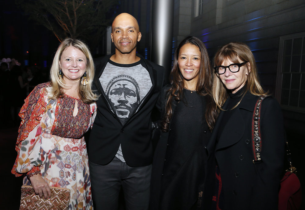 """Left to right, Curator Dorothy Moss, artist Kadir Nelson, Jungmiwha Bullock and Kate Capshaw attend the """"Face Forward Artist Party"""" at the Smithsonian's National Portrait Gallery on Saturday, November 10, 2018, in Washington.  ©Photo by Paul Morigi/AP Images for National Portrait Gallery)"""