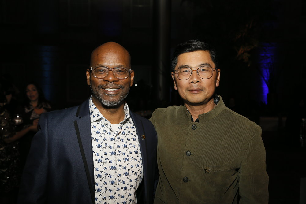 """Artist Jefferson Pinder, left, and artist Byron Kim, right, attend the """"Face Forward Artist Party"""" at the Smithsonian's National Portrait Gallery on Saturday, November 10, 2018, in Washington.  ©Photo by Paul Morigi/AP Images for National Portrait Gallery)"""
