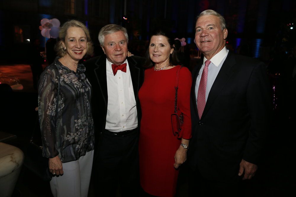 """Left to right, Wendy Wick Reaves, John Reaves, Patricia Quealy Moore and Walter Moore attend the """"Face Forward Artist Party"""" at the Smithsonian's National Portrait Gallery on Saturday, November 10, 2018, in Washington.  ©Photo by Paul Morigi/AP Images for National Portrait Gallery)"""