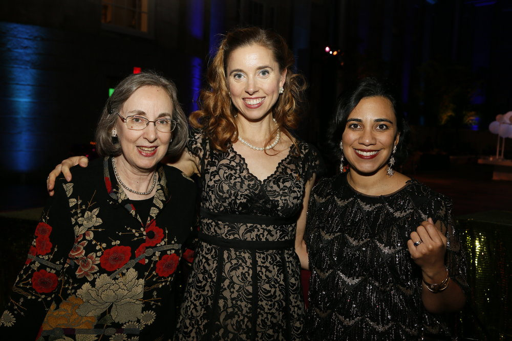 """Left to right, curator Ann Shumard, artist Jessica Todd Harper, and curator Leslie Ureña attend the """"Face Forward Artist Party"""" at the Smithsonian's National Portrait Gallery on Saturday, November 10, 2018, in Washington.  ©Photo by Paul Morigi/AP Images for National Portrait Gallery)"""