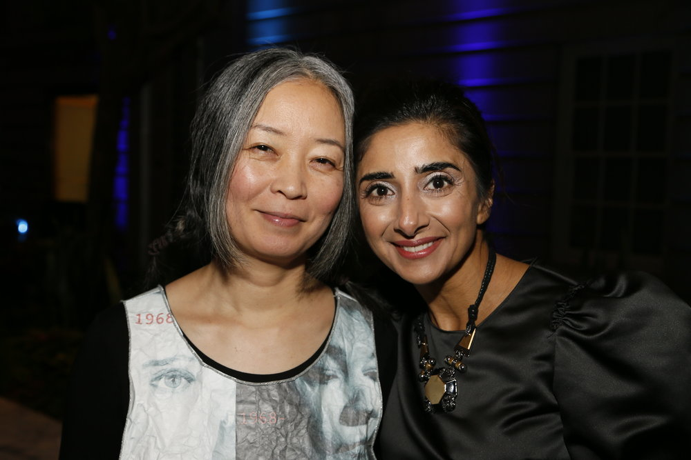"""Artist Kumi Yamashita, left, and curator Asma Naeem, right, attend the """"Face Forward Artist Party"""" at the Smithsonian's National Portrait Gallery on Saturday, November 10, 2018, in Washington.  ©Photo by Paul Morigi/AP Images for National Portrait Gallery)"""
