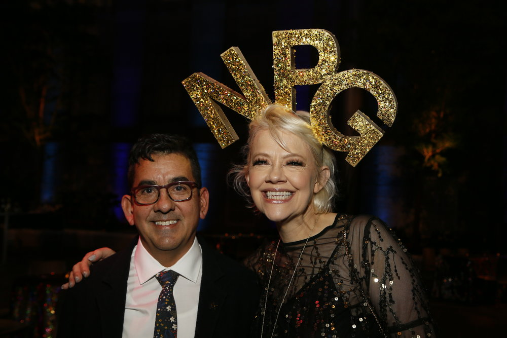 """Artist Ken Gonzales-Day, left, and National Portrait Gallery Director Kim Sajet, right, attend the """"Face Forward Artist Party"""" at the Smithsonian's National Portrait Gallery on Saturday, November 10, 2018, in Washington.  ©Photo by Paul Morigi/AP Images for National Portrait Gallery)"""