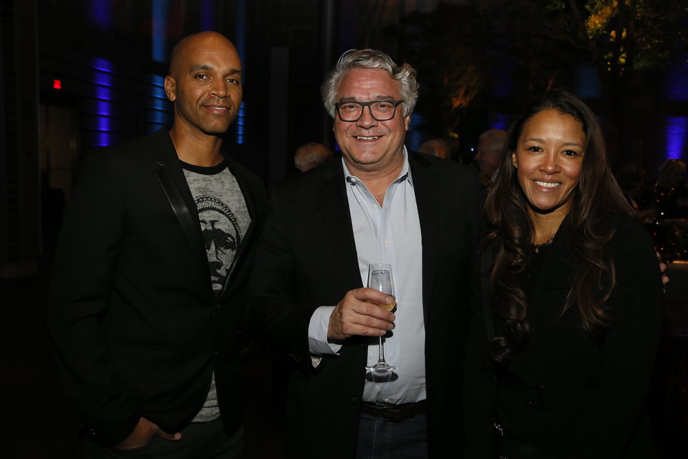"""Left to right, artist Kadir Nelson, Joe Ujobai and Jungmiwha attend the """"Face Forward Artist Party"""" at the Smithsonian's National Portrait Gallery on Saturday, November 10, 2018, in Washington.  ©Photo by Paul Morigi/AP Images for National Portrait Gallery)"""