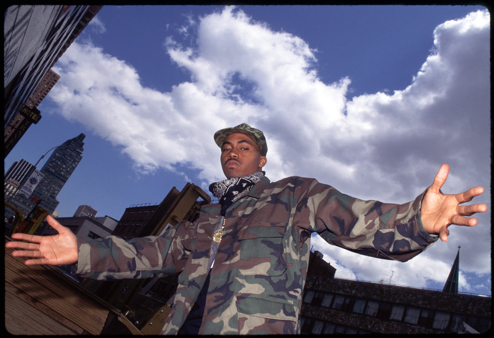 Nas with clouds. Courtesy of ©  Hip-Hop at the End of the World  by Ernie Paniccioli, Universe Publishing. 2018. Photography © Ernest Paniccioli.
