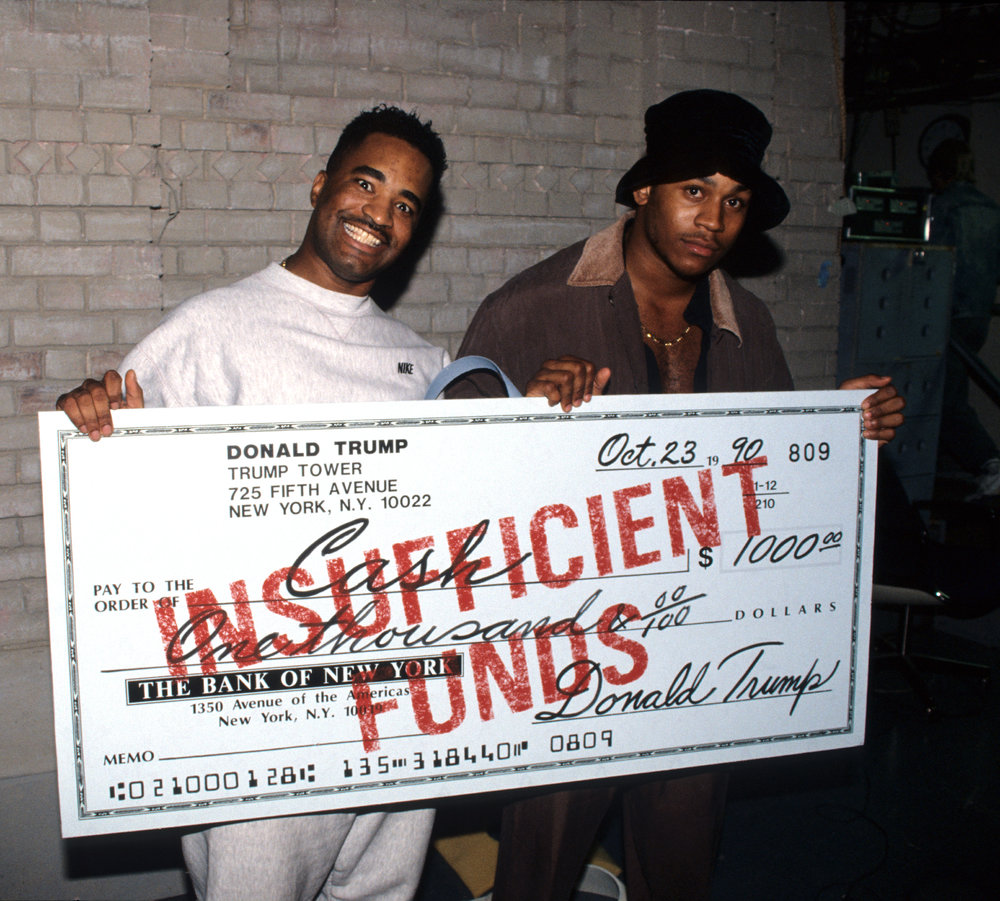 LL Cool J and Marley Marl with Trump check. Courtesy of ©  Hip-Hop at the End of the World  by Ernie Paniccioli, Universe Publishing. 2018. Photography © Ernest Paniccioli.