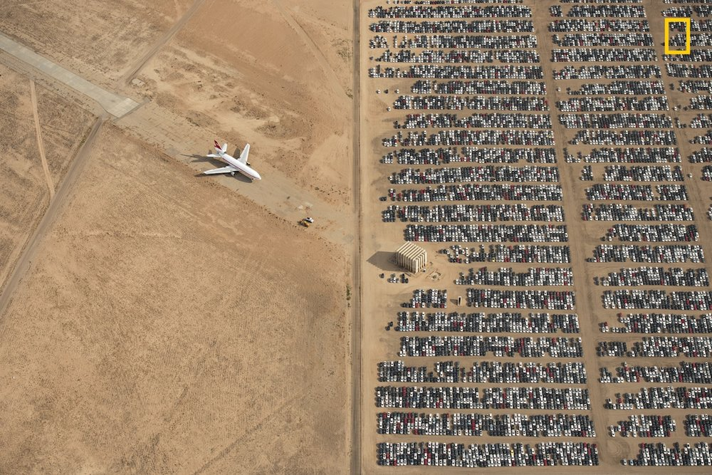 """Unreal"" Grand Prize Winner. First place, Places. ""Thousands of Volkswagen and Audi cars sit idle in the middle of California's Mojave Desert. Models manufactured from 2009 to 2015 were designed to cheat emissions tests mandated by the U.S. Environmental Protection Agency. Following the scandal, Volkswagen recalled millions of cars. By capturing scenes like this one, I hope we will all become more conscious of and more caring toward our beautiful planet."" (Photo and caption by Jassen Todorov / 2018 National Geographic Photo Contest)"