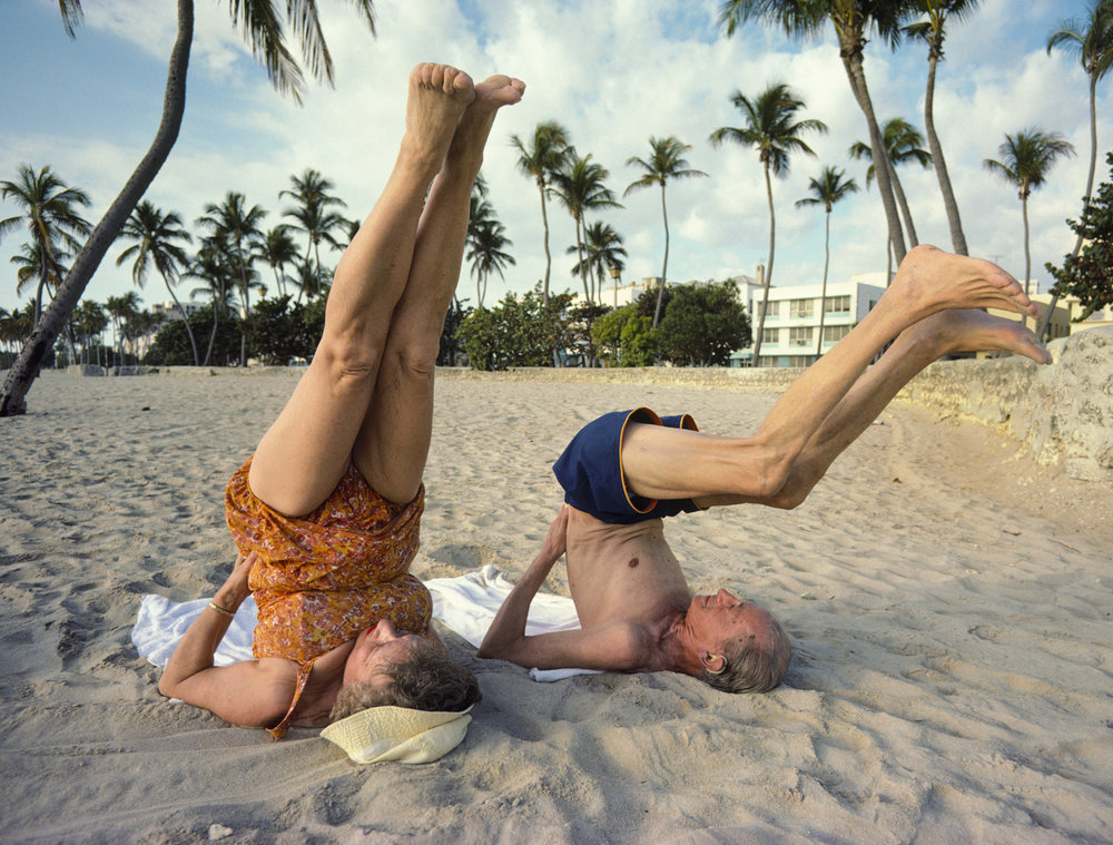 Eli and Helen Fricklas of Brooklyn practice yoga in Lummus Park, Miami Beach