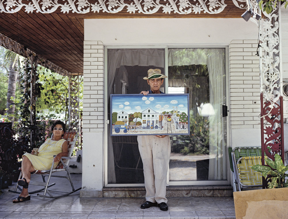 "Cuban-born ""Memory Artist"" Mario Sanchez began painting in 1930 on paper bags and cedar wood boards. He is best known for bas relief wood carvings that he painted over in vibrant colors, usually depicting scenes of Key West. At his home, Key West"