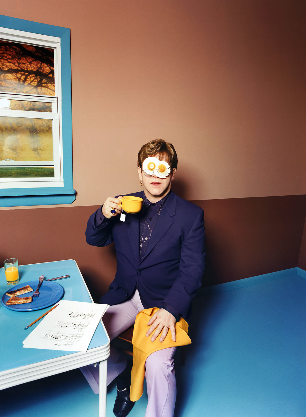 """Elton John: Egg On His Face, 1999"". David LaChapelle. © David LaChapelle / Courtesy Staley-Wise Gallery, New York"