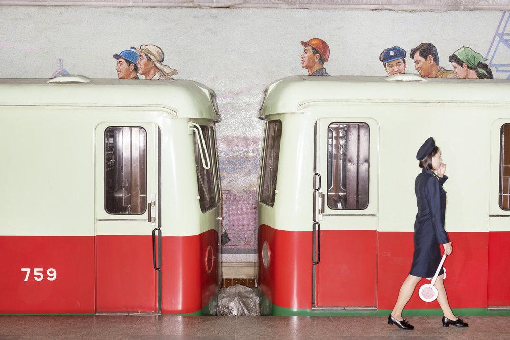 Wagon and wall mural at Pyongyang subway. © Max Pinckers