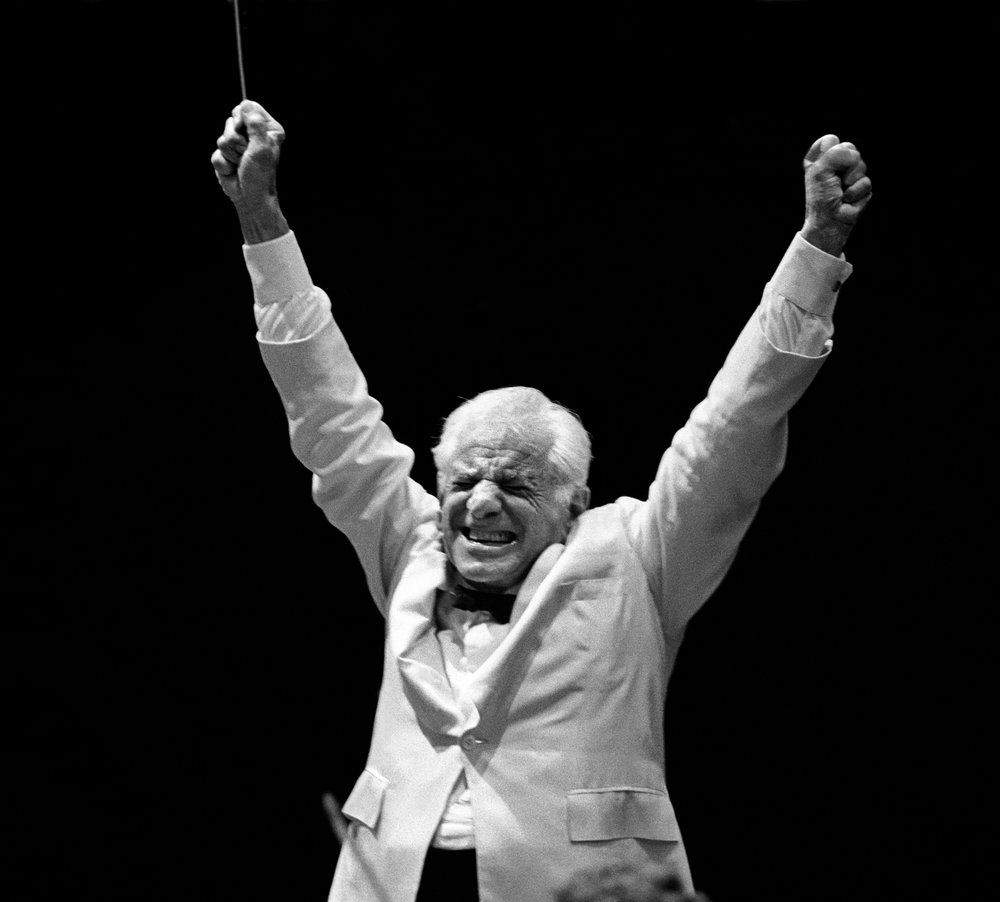 "August 1986. Central Park, New York City. Leonard Bernstein conducting the New York Philharmonic in Tchaikovsky's ""Symphony No. 6, Pathétique."" Photograph by © Steve J. Sherman"