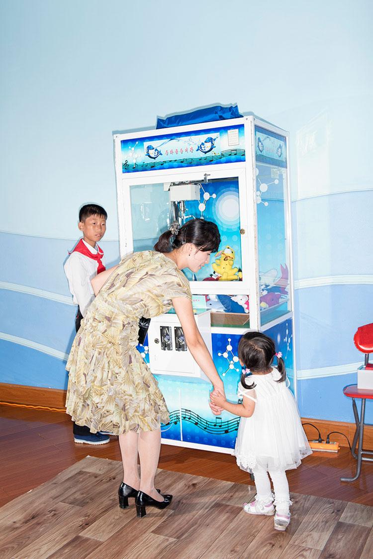Families enjoying the National Liberation Day (Aug.15) at the Rungna Dolphinarium, Pyongyang. © Max Pinckers