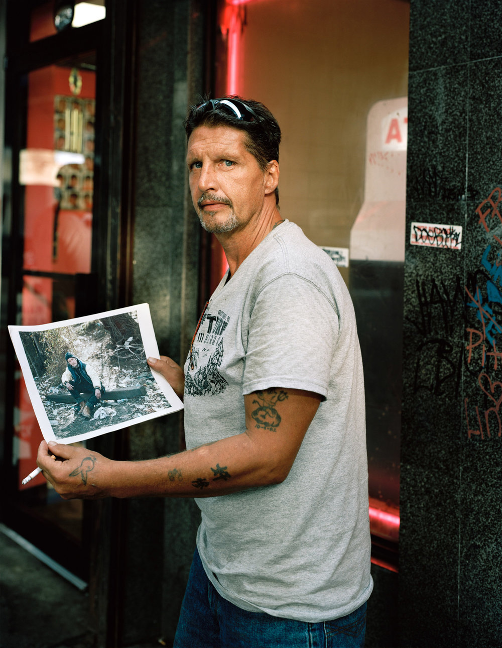 Robert holds a page of his recently deceased brother Edward. Kensington & Somerset Street. 2011. © Jeffrey Stockbridge